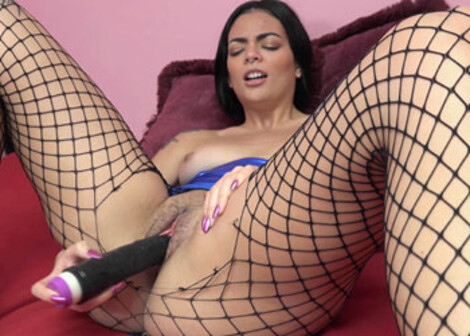 Milly fucks a dildo in her torn pantyhose